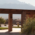 View of shade structure, foothills and Sandias from pocket park breezeway